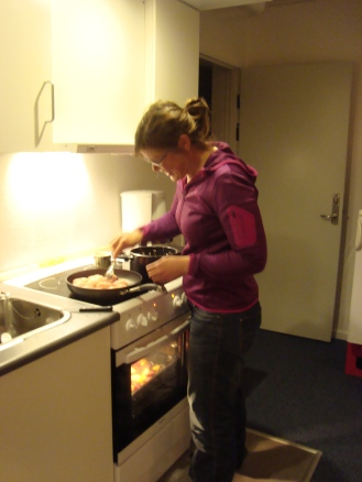 My colleague cooking in the communal kitchen at the hotel.